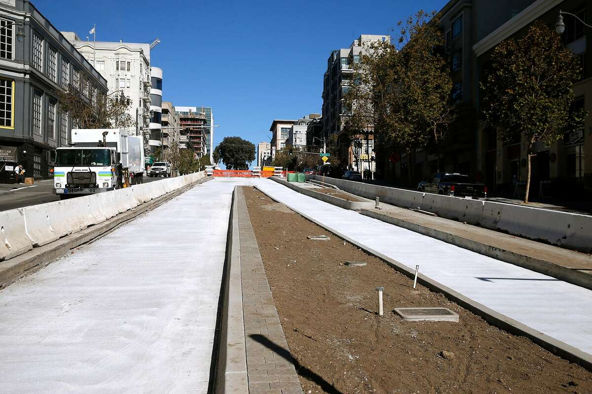 Transit lanes begin to take shape at Turk Street as construction on the bus rapid transit project continues on Van Ness Avenue in San Francisco, Calif. on Wednesday, Oct. 14, 2020. The Van Ness Improvement Project is behind schedule but the SFMTA says when completed it will vastly improve public transportation and traffic through the busy corridor.