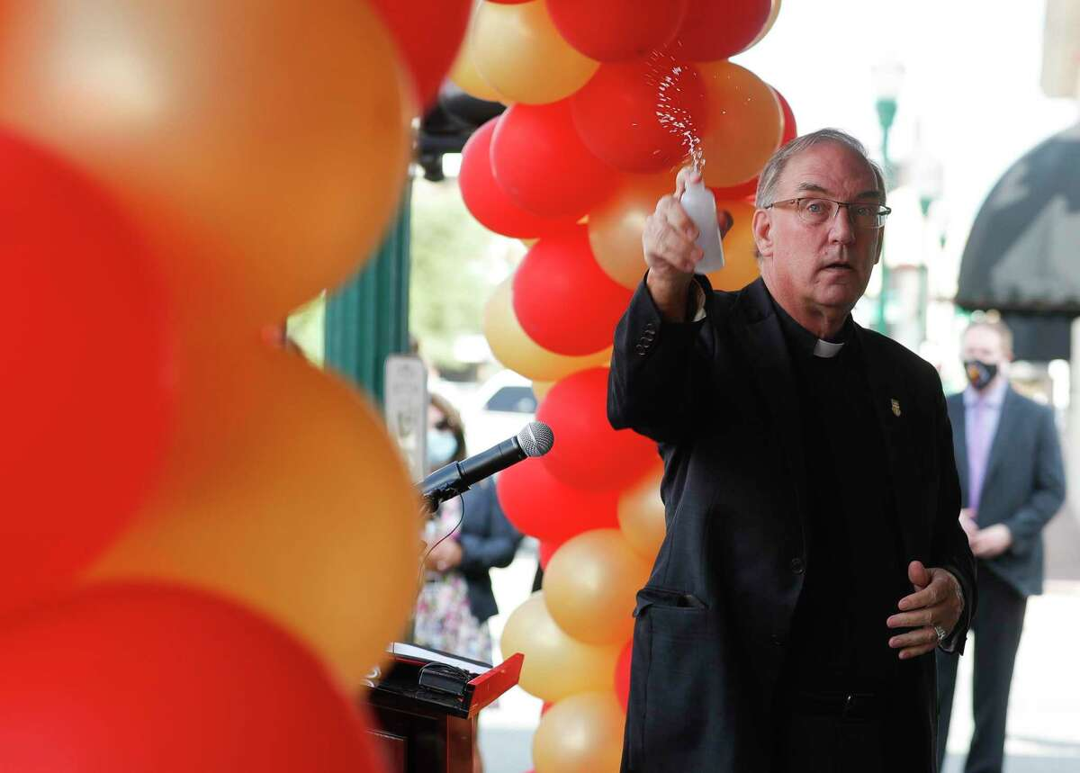 Father Paul English blesses the University of St. Thomas' new 1,500 square foot UST MAX Center microcampus, Tuesday, Oct. 20, 2020, in downtown Conroe.