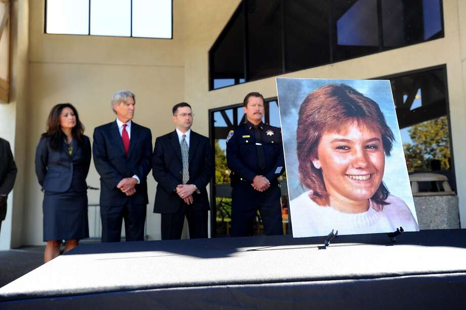 Police investigators and prosecutors stand behind a photo of Tina Faelz, who was 14 years old when murdered, during a news conference announcing the arrest of Steven Carlson at the Pleasanton Police Department in August 2011. Photo: Noah Berger / Special To The Chronicle 2011