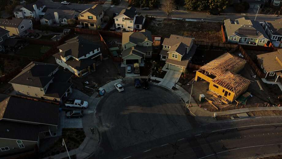 The homes at Rita Place and Hopper Avenue in the Coffey Park neighborhood, Wednesday, Oct. 7, 2020, in Santa Rosa, Calif. The neighborhood continues to be rebuilt after being destroyed in the Tubbs Fire of October 2017. Photo: Santiago Mejia / The Chronicle