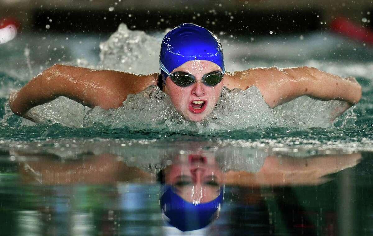 Darien's Kendall Luecke wins the 100 meter butterfly at the high school girls swim meet between Darien and Greenwich at Greenwich High School in Greenwich, Conn. Thursday, Oct. 15, 2020.
