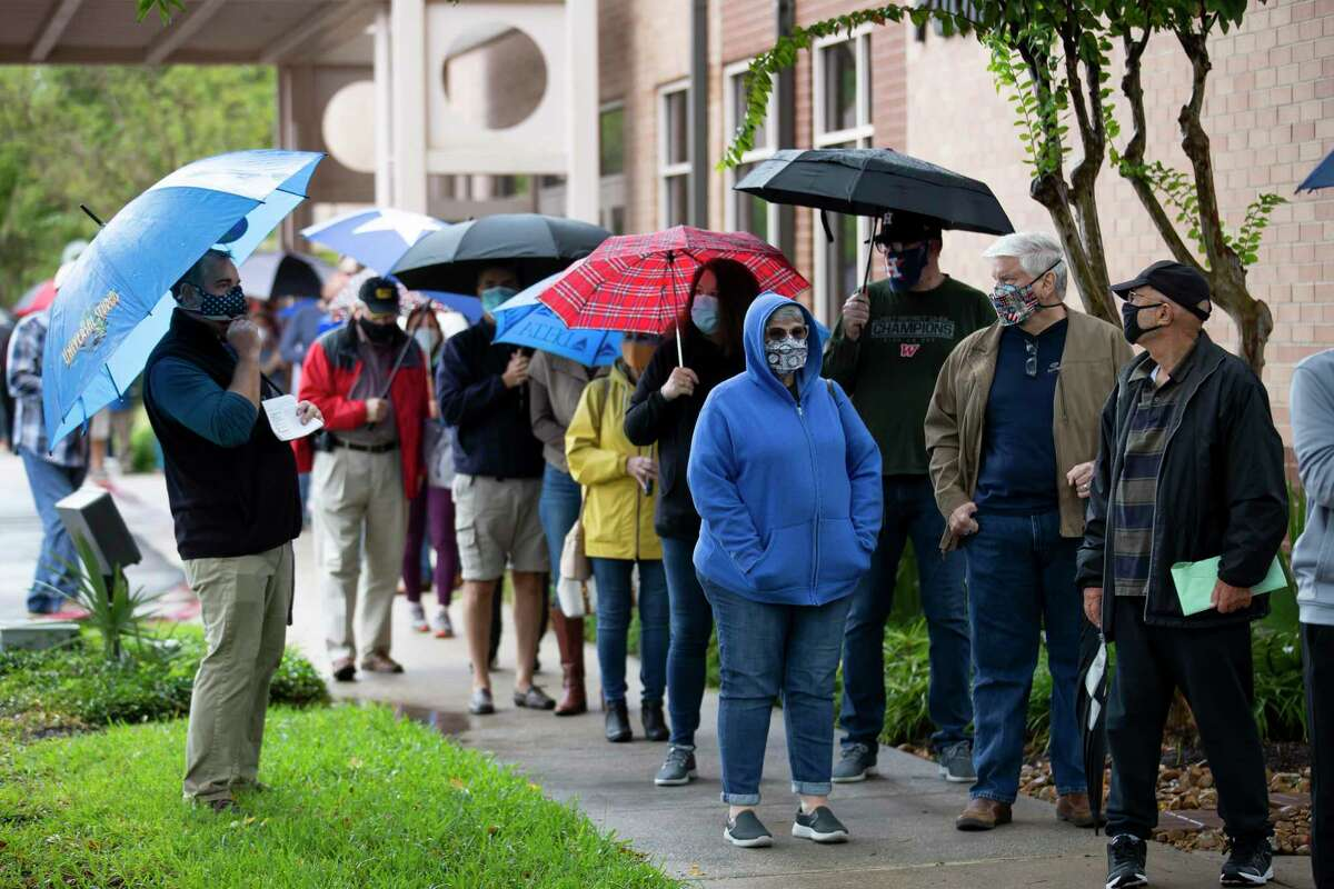 Voters brace through chilly temperatures and sporadic showers on the third day of Early Voting outside the South Regional Library, Friday, Oct. 16. Early, in-person voting continues through 7 p.m. Friday, Oct. 30, at various locations in Montgomery County. Election day voting runs from 7 a.m. to 7 p.m., Tuesday, Nov. 3.