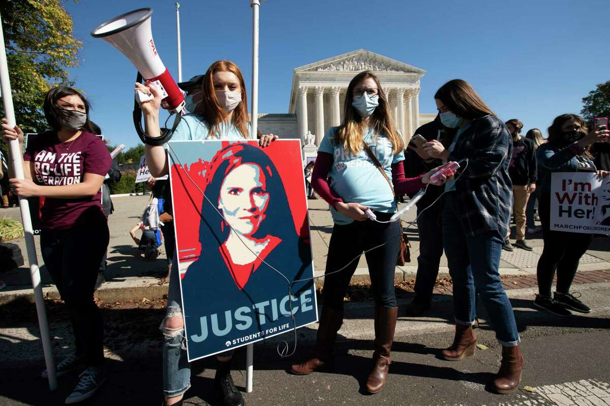 Supporters of Supreme Court nominee Amy Coney Barrett rally outside the Supreme Court building during the Women's March in Washington, D.C., on Saturday.