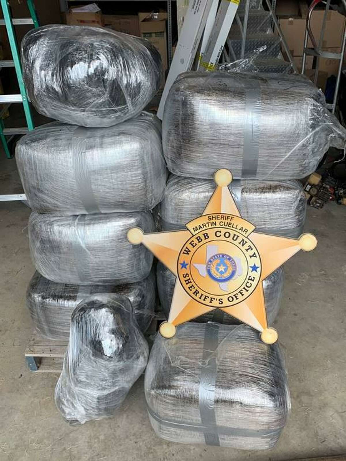 Authorities said they seized these nine bundles of marijuana from a home in central Laredo. The contraband weighed about 206 pounds and had an estimated street value of $61,800.