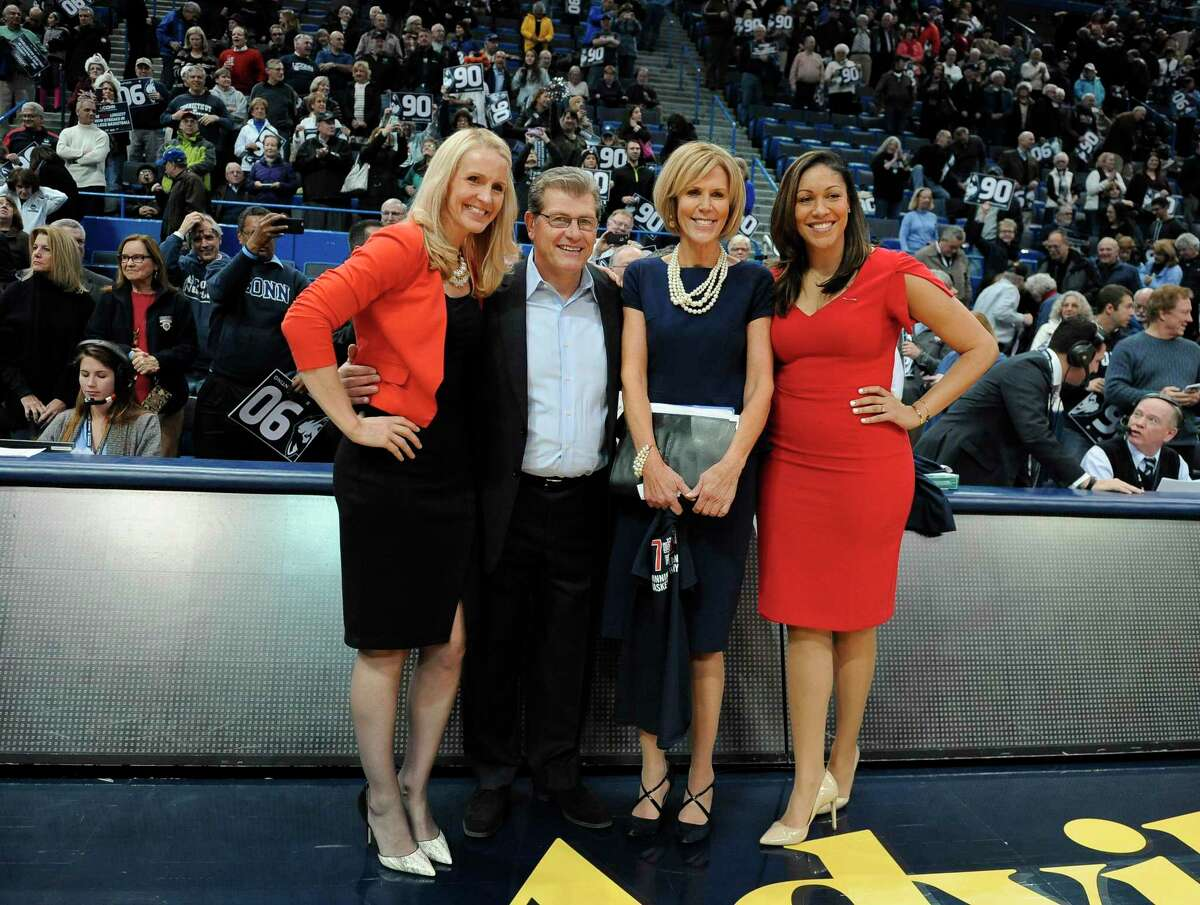 UConn assistant coach Shea Ralph, head coach Geno Auriemma, associate head coach Chris Dailey, and assistant coach Marisa Moseley pose for a photo in 2017. UConn has agreed to pay a total of just under $250,000 to seven women, including four members of Auriemma's 2014 staff, after the U.S. Labor Department found they had been underpaid when compared with men in similar positions.