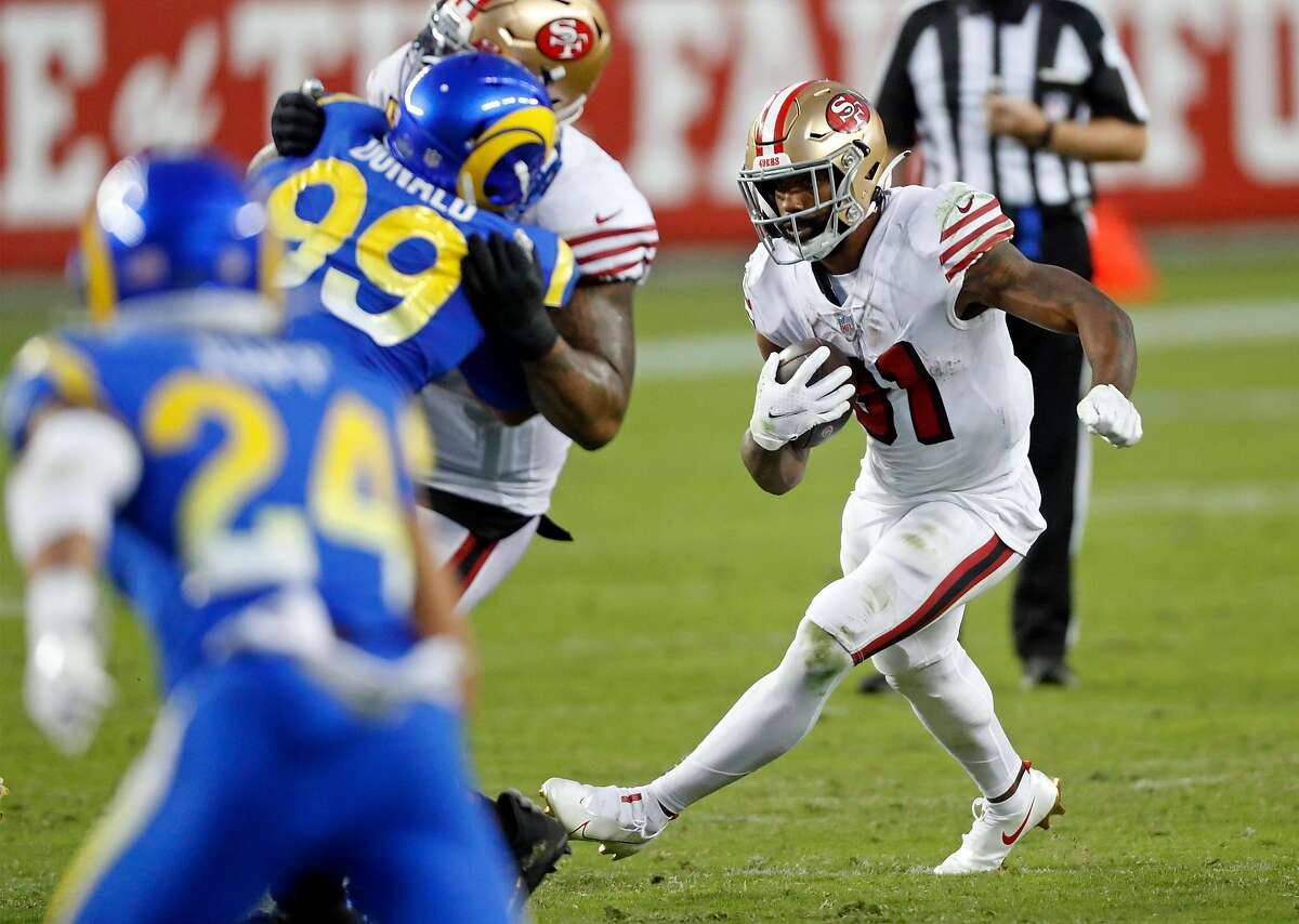 San Francisco 49ers' Raheem Mostert rushes in 2nd quarter against Los Angeles Rams during NFL game at Levi's Stadium in Santa Clara, Calif., on Sunday, October 18, 2020.