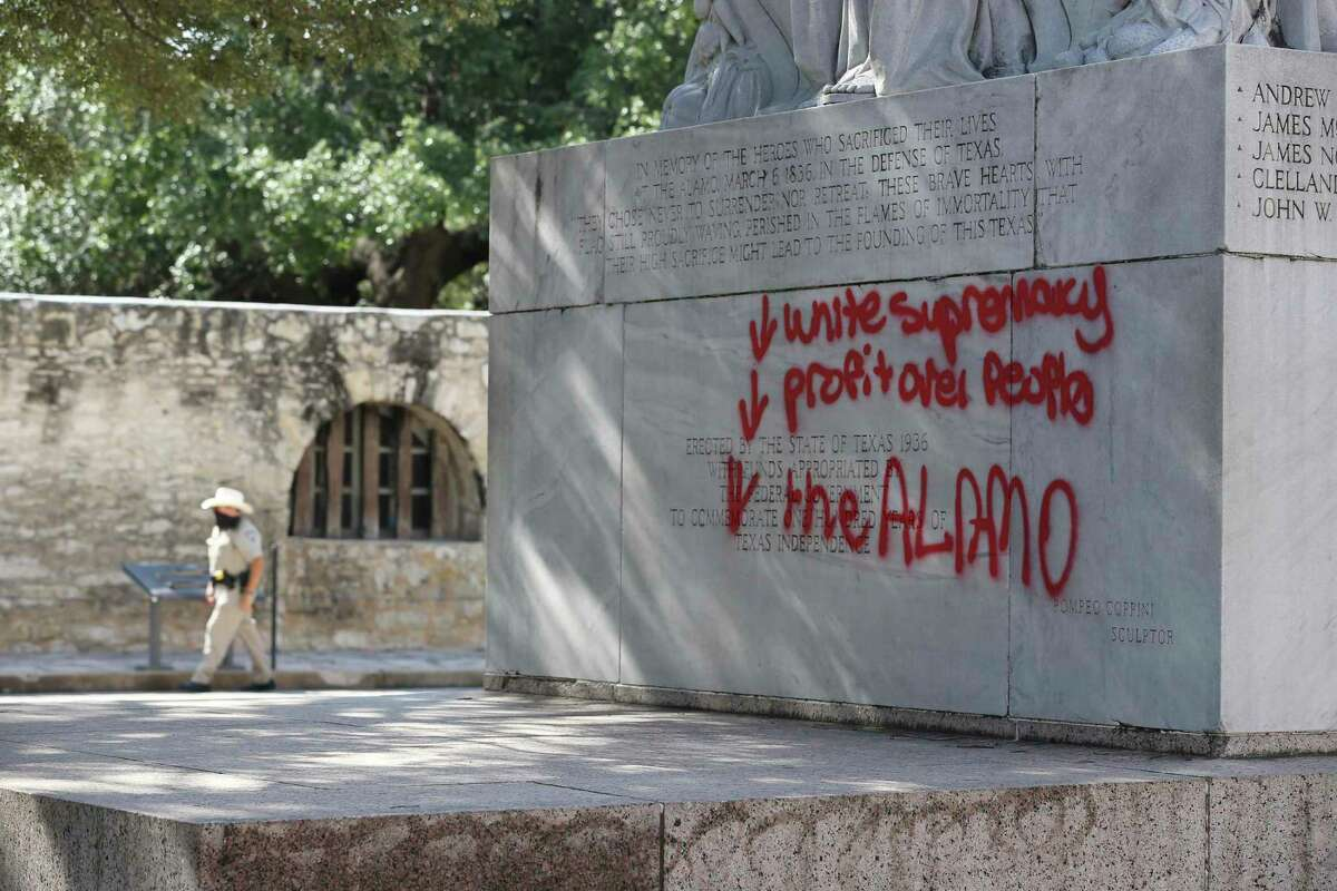 Graffiti is seen on the Cenotaph as an Alamo Ranger patrol the area, Friday, May 29, 2020.