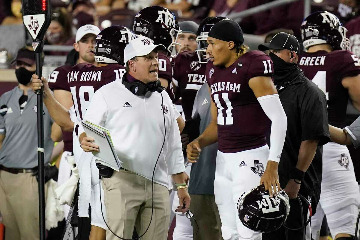 Jimbo Fisher, with quarterback Kellen Mond in the opener against Vanderbilt, reminds his players they have a long way to go and not to get carried away by early press clippings.