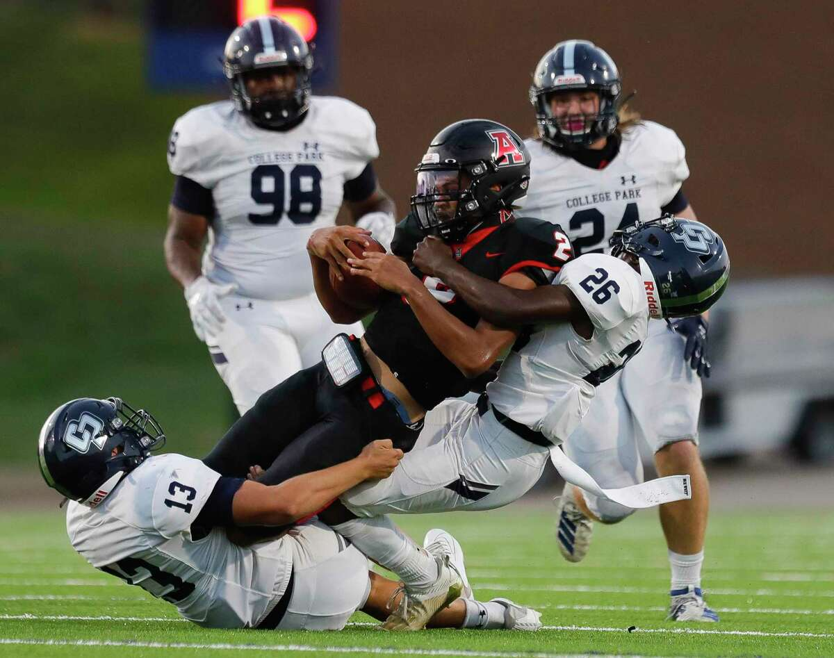 Fort Bend Austin quarterback Joshua Tarver (2) is brought down by College Park linebacker Kris Schneider (13 and defensive back Jaeren Taylor (25) during the second quarter of a non-district high school football game at Edward Mercer Stadium, Saturday, Oct. 10, 2020, in Sugar Land.