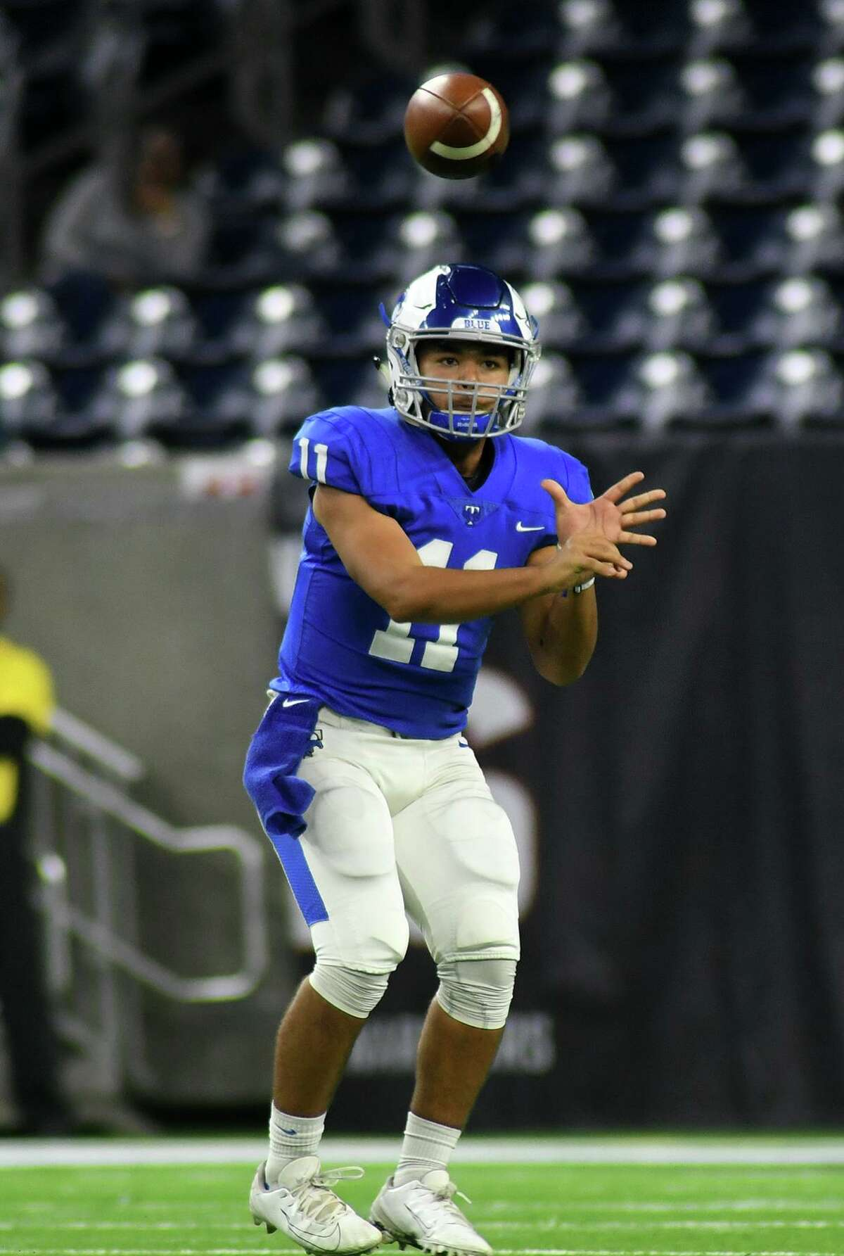 Katy Taylor junior quarterback J Jensen III targets a Mustang receiver on a pass play against Humble in the second quarter of their Region III-6A semi-final matchup at NRG Stadium on Saturday, Nov. 30, 2019.