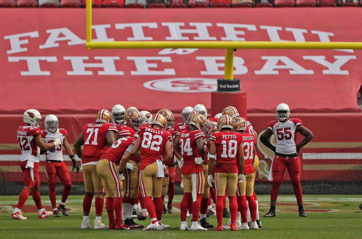 The 49ers huddle late in the second half as the San Francisco 49ers played the Arizona Cardinals at Levi's Stadium in Santa Clara, Calif., on Sunday, September 13, 2020.