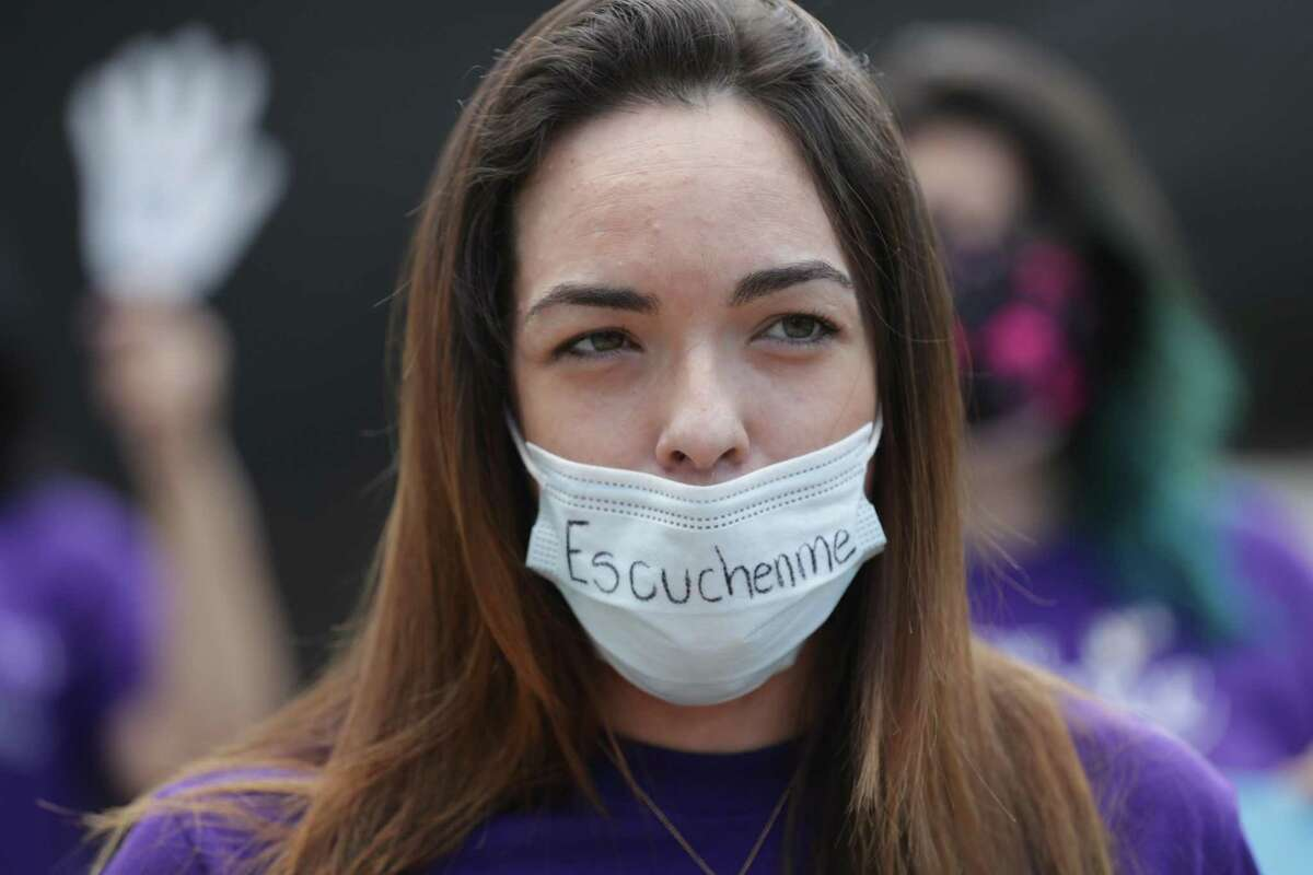 Andrea Prato talks about how her abuser is free during a FIEL press conference to denounce inconsistencies in the way domestic violence cases are handled by law enforcement and the court system Tuesday, Oct. 20, 2020, in downtown Houston.