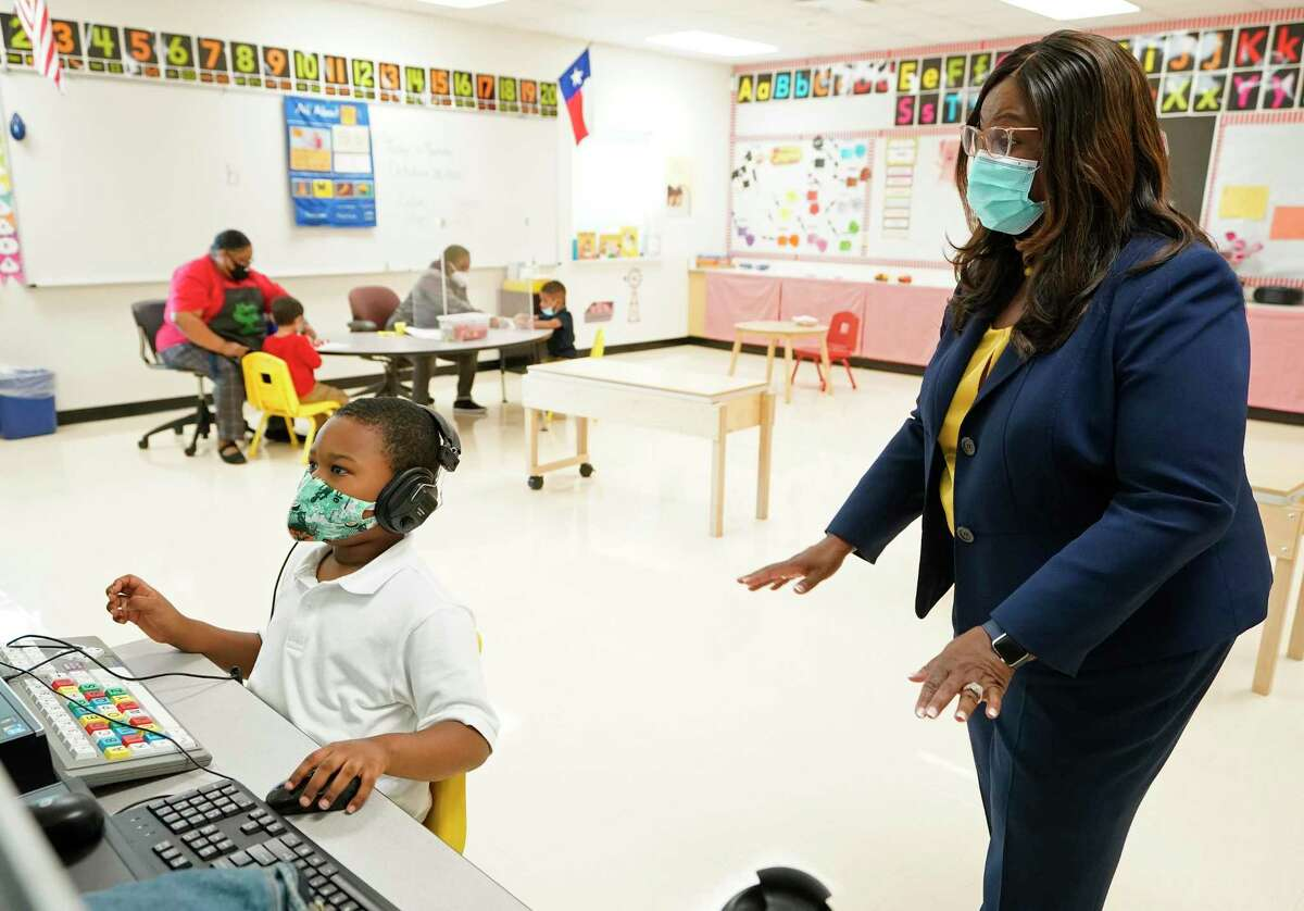 Houston ISD Interim Superintendent Grenita Lathan visits an Atherton Elementary School classroom Tuesday, the second day of in-person instruction in the district. HISD officials said 16 schools temporarily closed Tuesday or would close Wednesday, the district's first shutdowns since reopening buildings to students.