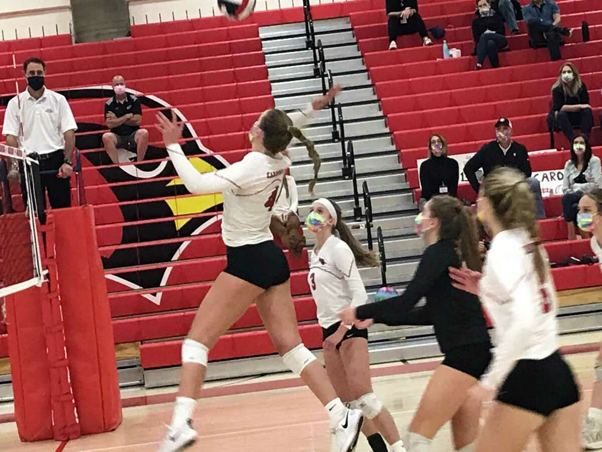Greenwich senior Cornelia Roach posts a kill during the Cardinals match against Stamford.