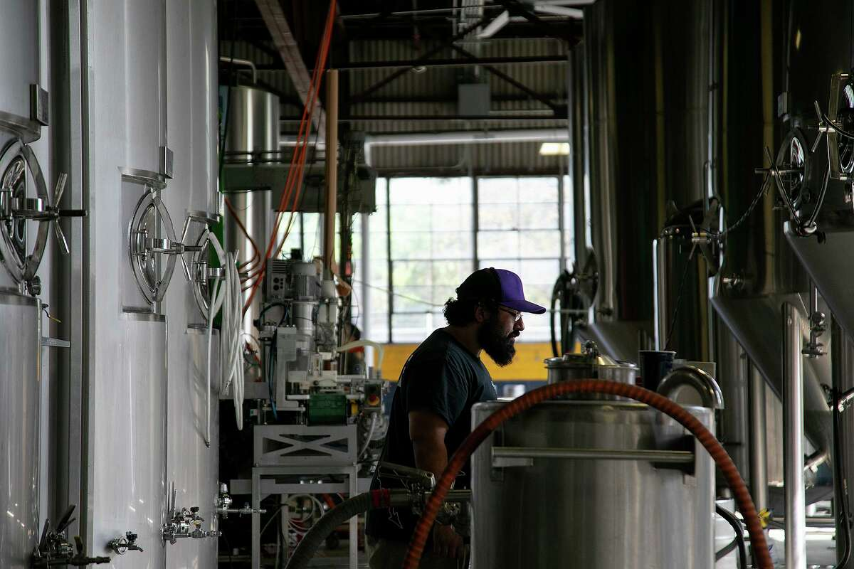 Assistant brewer Alex Garcia works in the brewery at Freetail Brewing Co. in San Antonio on Friday, Oct. 16, 2020.
