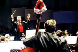 Alton Symphony Orchestra's Maestro Wm. Shane Williams cues the orchestra.