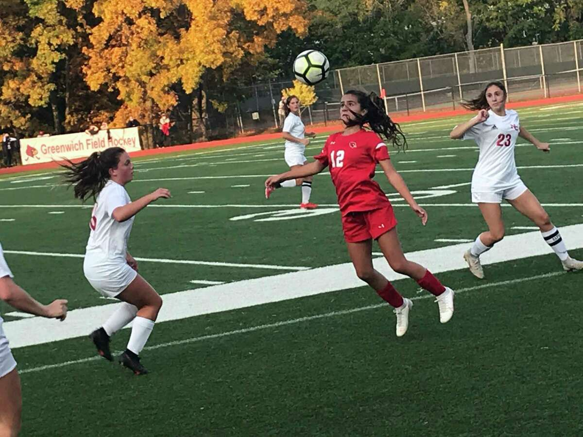 The Greenwich and New Canaan soccer teams played to a 1-1 draw.