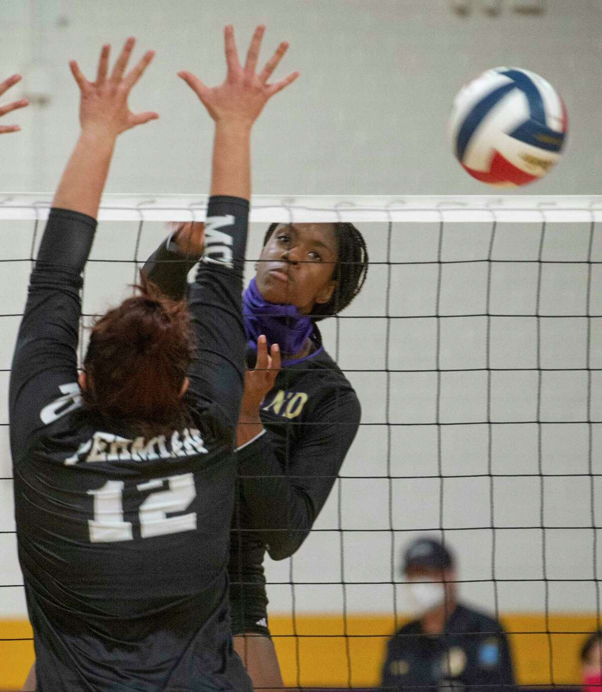 Midland High's Aniya Clinton gets the ball past the reach of Permian's Monica Hinojos 10/20/2020 at the Midland High gym. Tim Fischer/Reporter-Telegram