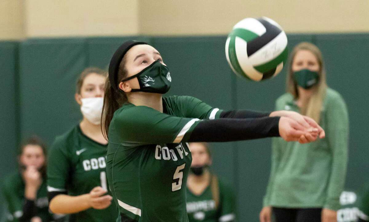 John Cooper setter Lauren Harkness (5) returns a serve during the second set of a Southwest Preparatory Conference match against Episcopal at The John Cooper School, Tuesday, Oct. 20, 2020.