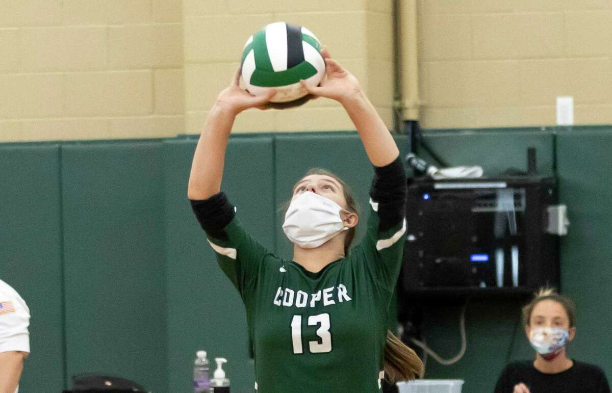 John Cooper setter Lauren Wolford (13) prepares a play during the first set of a Southwest Preparatory Conference match against Episcopal at The John Cooper School, Tuesday, Oct. 20, 2020.