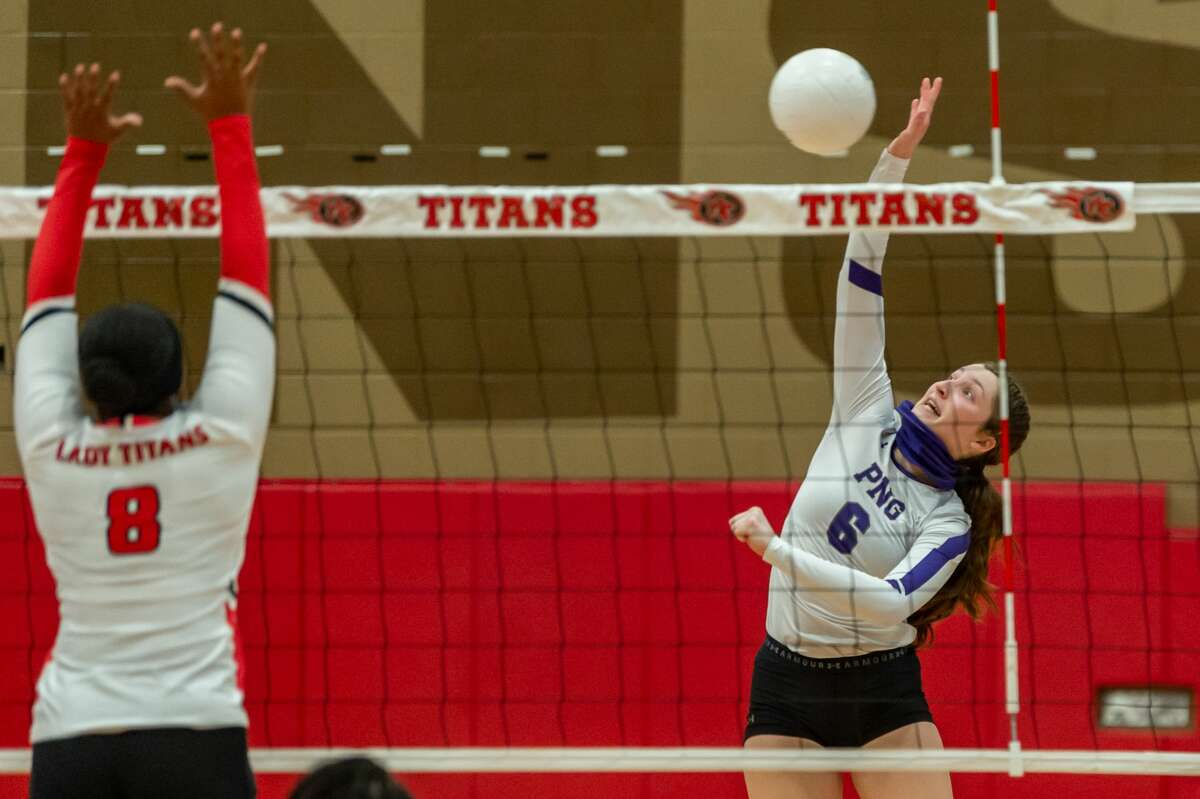 PN-G's Sarah Grove (6) knocks one over the net in the first set. Port Neches-Groves Volleyball brought their winning ways to Port Arthur Memorial as they downed the Lady Titans in three sets on Tuesday nights. Photo made on October 20, 2020. Fran Ruchalski/The Enterprise