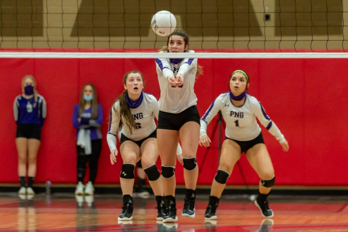 PN-G's Addison Bost (10) returns the serve, flanked by Sarah Grove (6) and Mariela Dubion (1). Port Neches-Groves Volleyball brought their winning ways to Port Arthur Memorial as they downed the Lady Titans in three sets on Tuesday nights. Photo made on October 20, 2020. Fran Ruchalski/The Enterprise