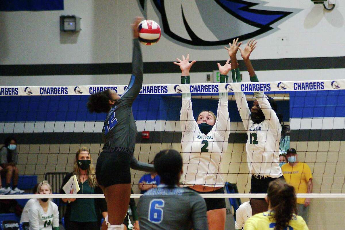 Clear Springs' Teia Woodson (12) tries to hit a shot past Clear Falls' Blakely Montgomery (2) and Clear Falls' Kade Thomas (12) Tuesday, Oct. 20 at Clear Springs High School.