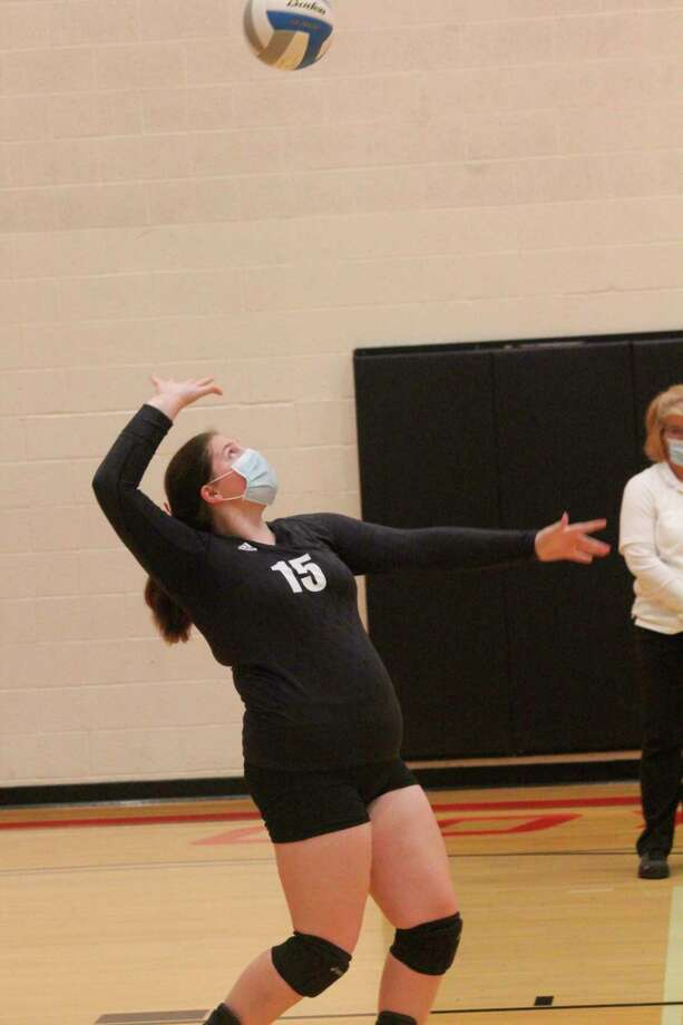 Reed City's Heather VanSyckle gets ready to serve against Fremont in Tuesday's CSAA match. (Pioneer photo/John Raffel)