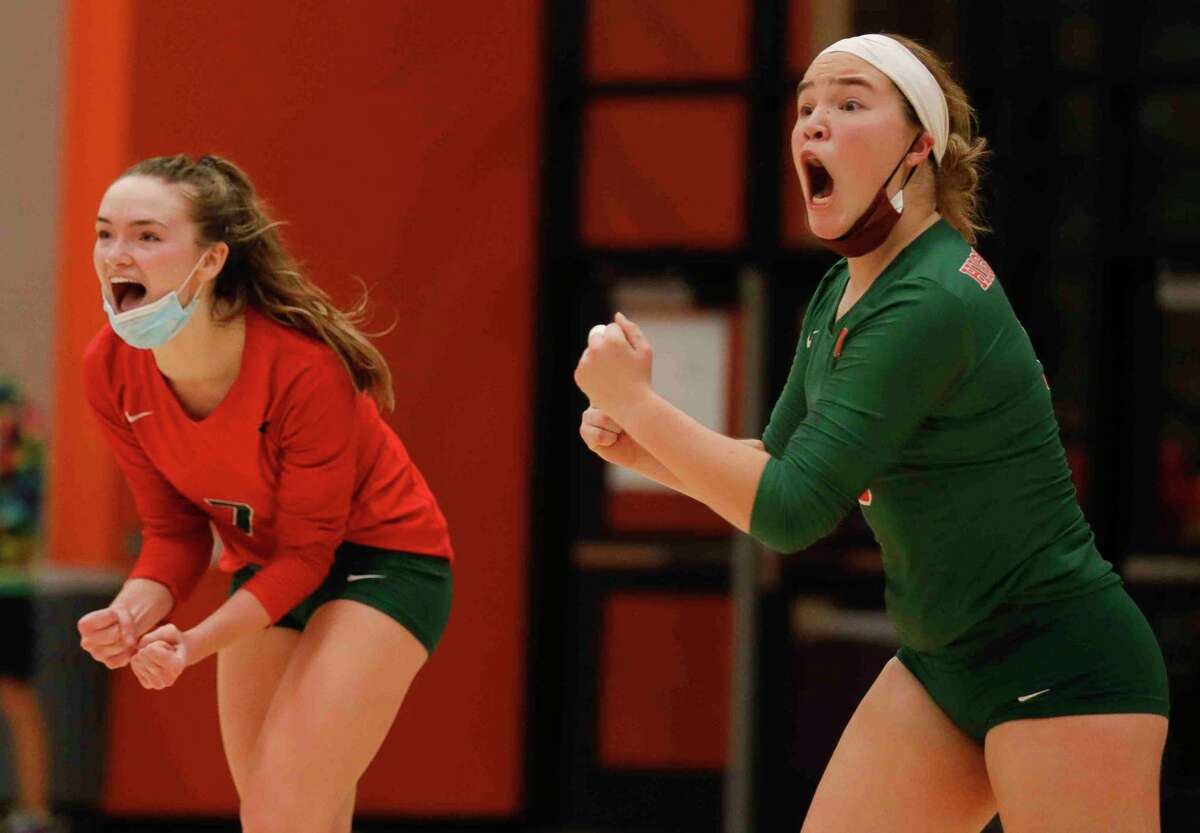 The Woodlands libero Jacqueline Lee (5) reacts beside outside hitter Claire Arena (7) after a point during the fifth set of a District 13-6A high school volleyball match at Grand Oaks High School, Tuesday, Oct. 20, 2020, in Spring.