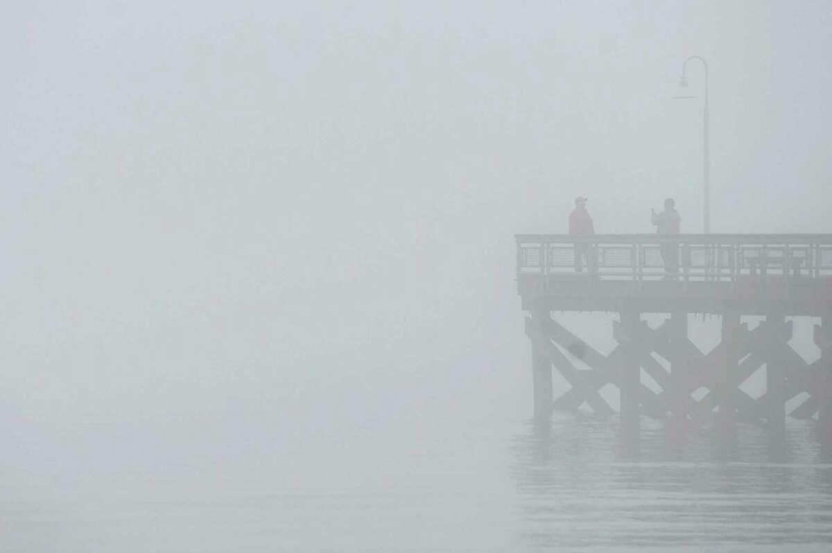 File photo of fog near the boardwalk at Cummings Beach in Stamford, Conn.