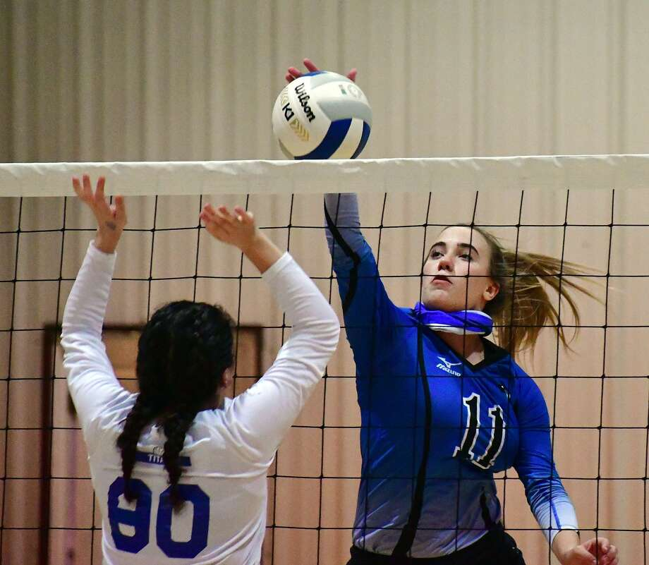 Plainview Christian Academy's Soraya Davey tries to hit past a Lubbock Home School defender during their high school volleyball match on Tuesday, Oct. 20, 2020 at PCA. Photo: Nathan Giese/Planview Herald