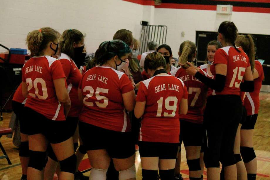 Bear Lake huddles during a timeout in their match against Onekama on Oct. 15. (File photo)