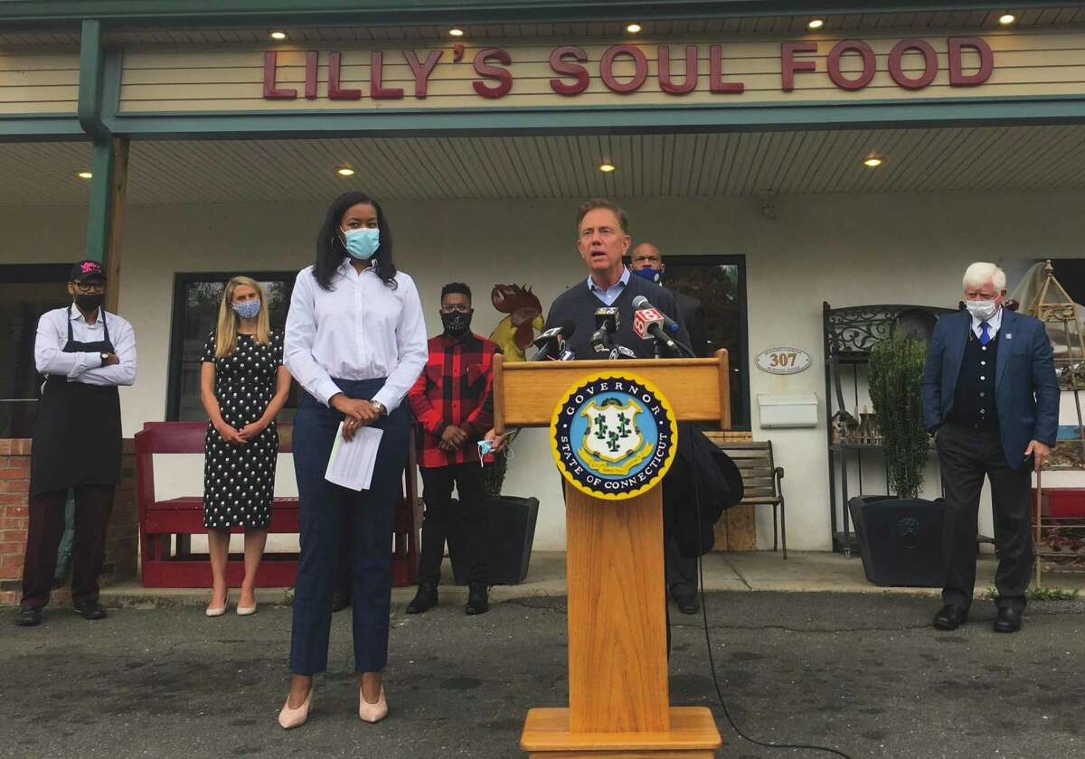 The state rolled out a $50 million program to help small businesses Tuesday, Oct. 20, 2020, at Lilly's Soul Food in Windsor. Pictured are Gov. Ned Lamont speaking alongside Glendowlyn Thames, deputy commissioner of the state Department of Economic and Community Development.