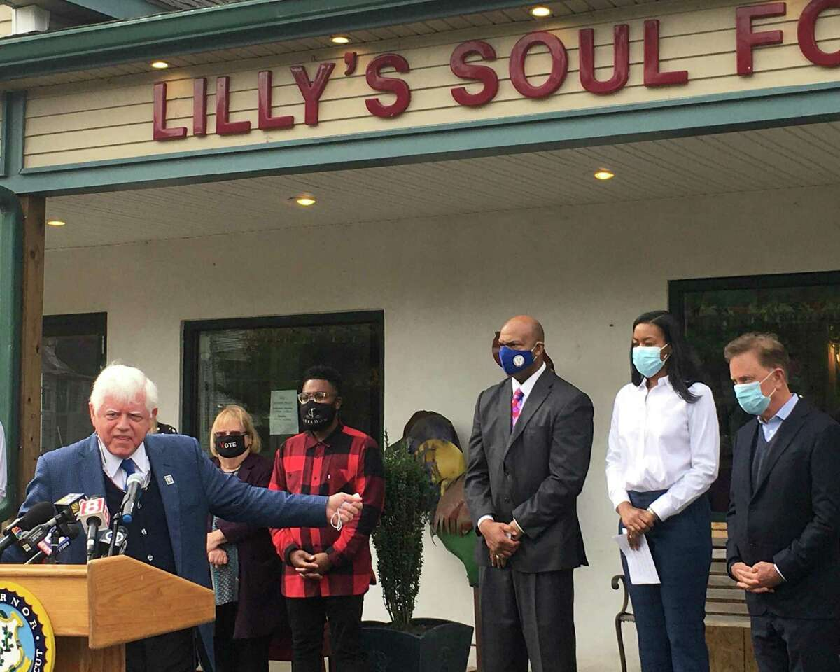 The state rolled out a $50 million program to help small businesses Tuesday, Oct. 20, 2020, at Lilly's Soul Food in Windsor. Pictured are U.S. Rep. John B. Larson, D-1, with Gov. Ned Lamont at far left; and Lamont speaking alongside Glendowlyn Thames, deputy commissioner of the state Department of Economic and Community Development.