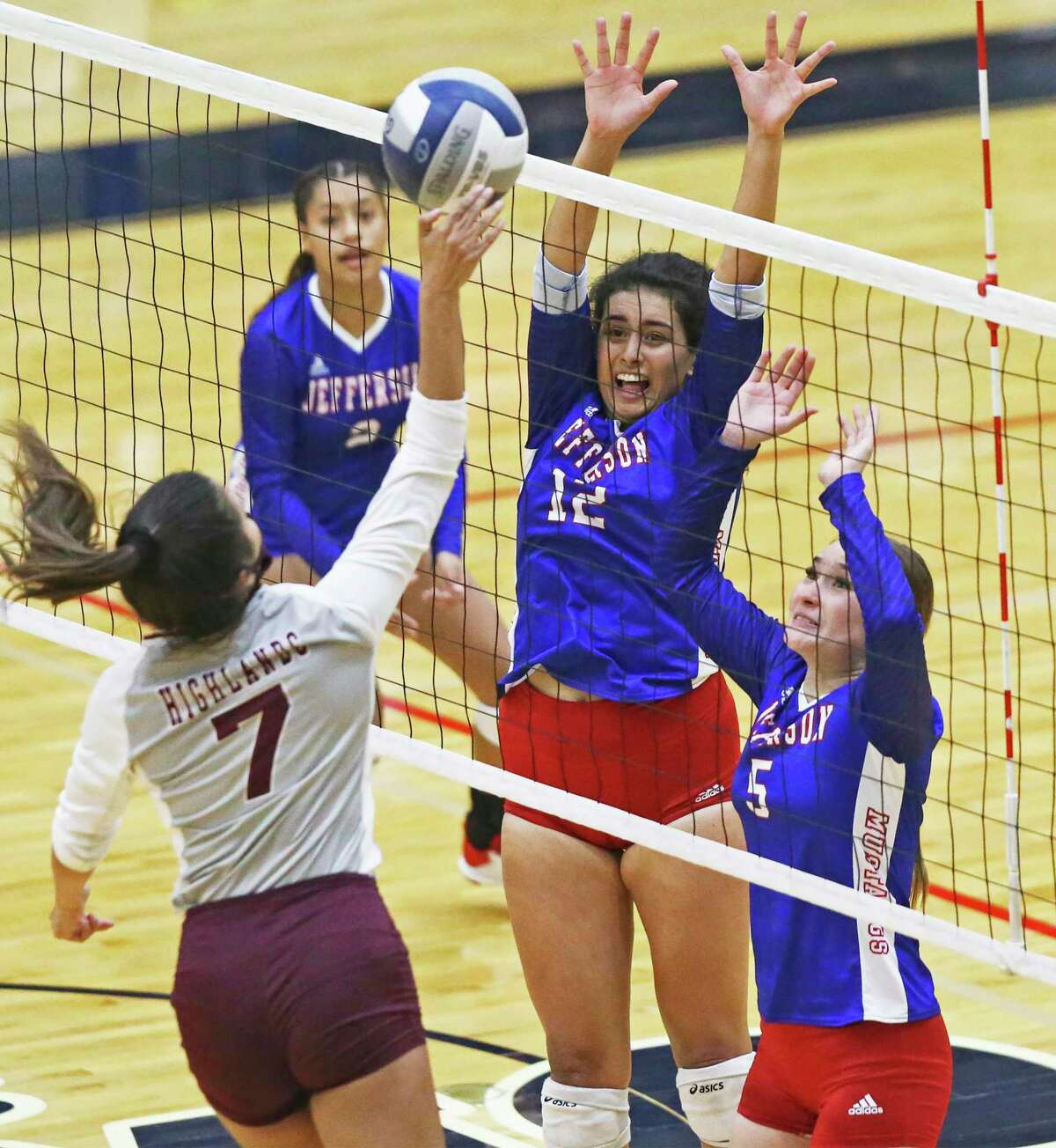Mustang defenders Jessa Torres (12) and Vanessa Segura try to stop a shot by Briana Conteras as Highlands beats Jefferson 3-0 in volleyball at Alamo Convocation Center on Oct.20, 2020.