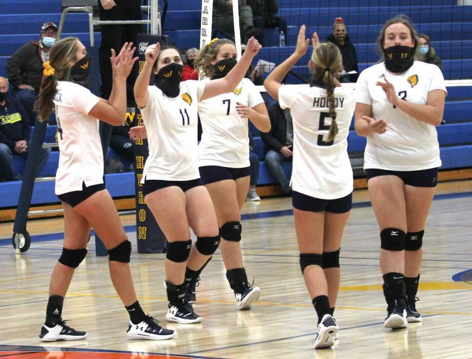 The North Huron varsity volleyball team celebrated homecoming week on Tuesday night with a sweep of visiting Carsonville-Port Sanilac. The Warriors won, 25-16, 25-19, 25-23, and remain perfect in league play. Photo: Mark Birdsall/Huron Daily Tribune