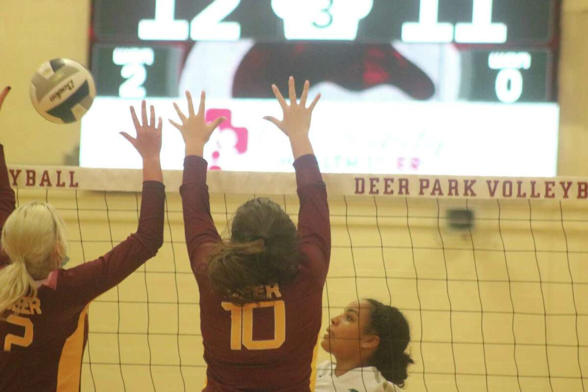 Phoebe Stigen (2) and Katelyn Mallet collect the block during Game 3 action at the DPHS North campus Tuesday night.