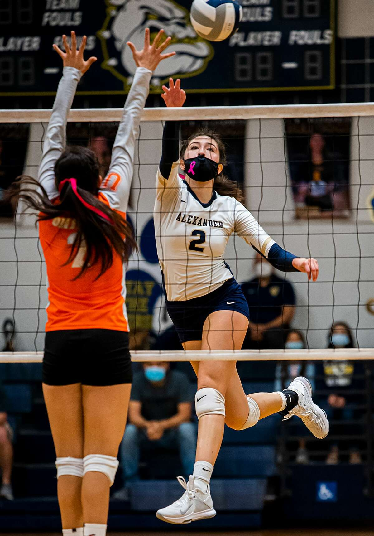 Alexander High School Anali Santos tips the ball over during a game against United High School, Tuesday, Oct. 20, 2020, at Alexander High School.