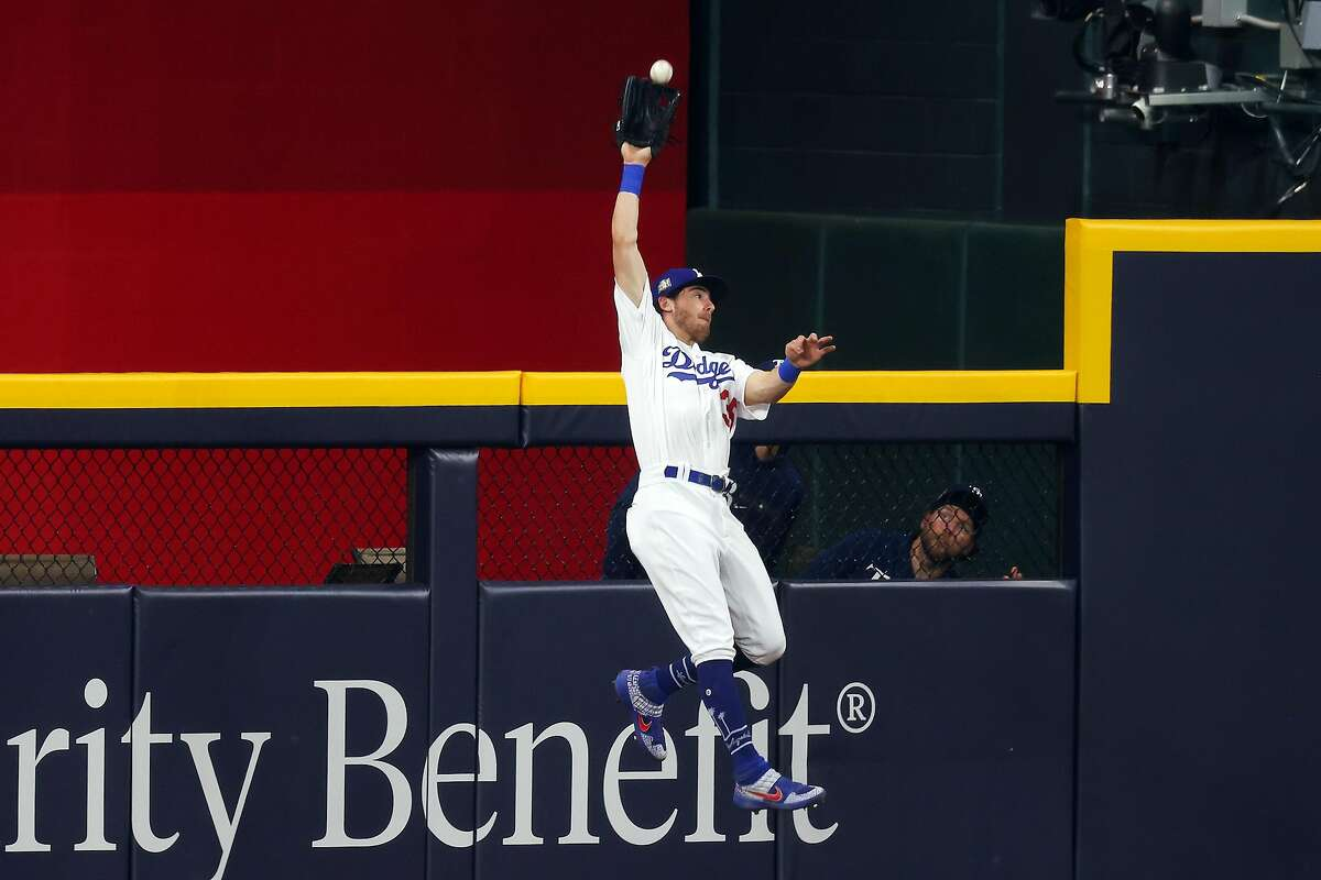 ARLINGTON, TEXAS - OCTOBER 20: Cody Bellinger #35 of the Los Angeles Dodgers catches a fly ball on a hit by Austin Meadows (not pictured) of the Tampa Bay Rays during the ninth inning in Game One of the 2020 MLB World Series at Globe Life Field on October 20, 2020 in Arlington, Texas. (Photo by Ronald Martinez/Getty Images)