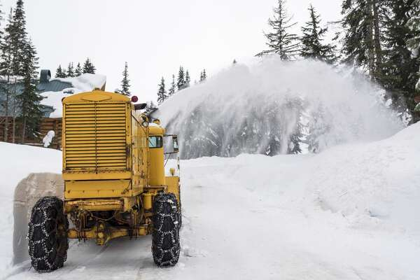 Winter snow plow equipment cleaning up street