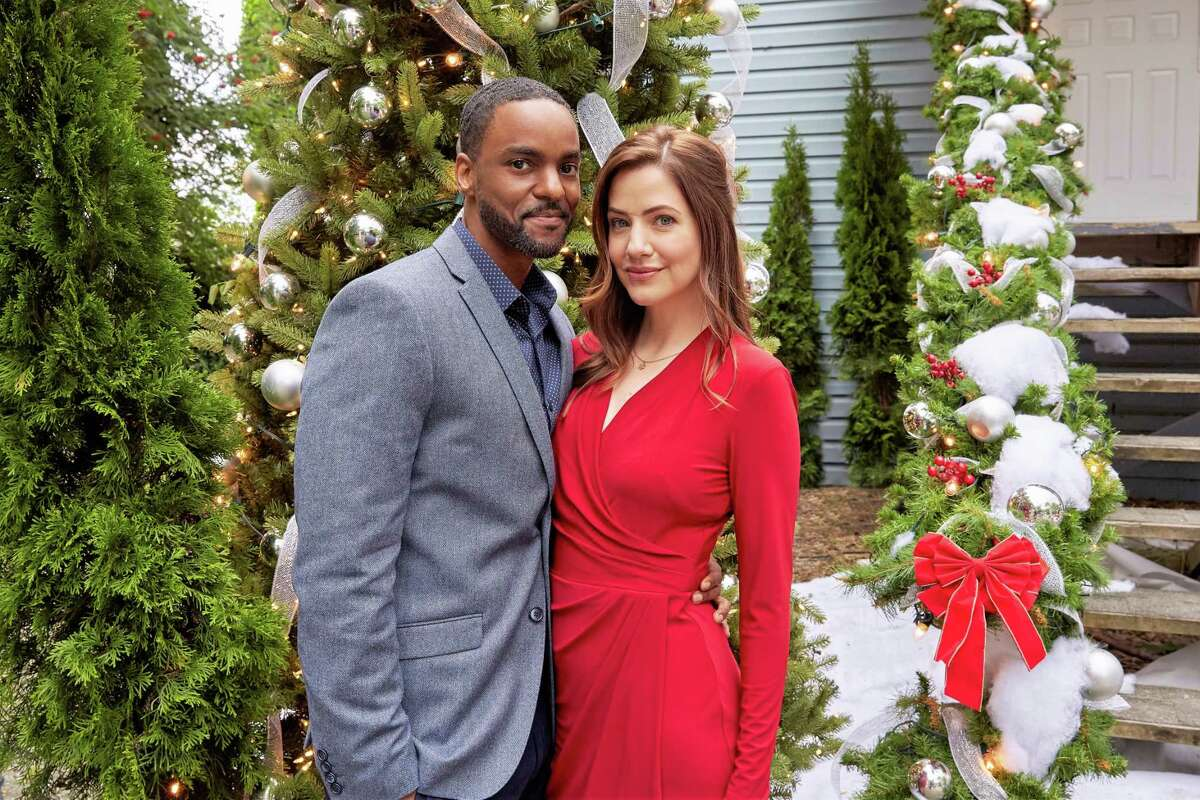 """""""Jingle Bell Bride,"""" airing at 7 p.m. Saturday, stars Julie Gonzalo as wedding planner Jessica Perez, who travels to a remote Alaska town to find a rare flower for a celebrity client and is charmed not only by the small town's Christmas vibe, but also by the handsome local (Ronnie Rowe Jr.) helping her."""