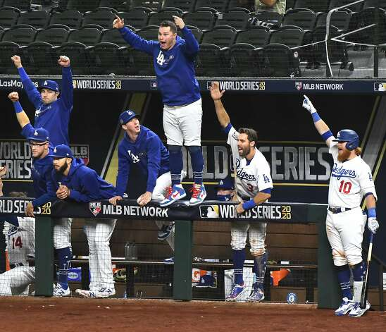 The Los Angeles Dodgers dugout celebrates a solo home run by Mookie Betts in the sixth inning against the Tampa Bay Rays in Game 1 of the World Series at Globe Life Field in Arlington, Texas, on Tuesday, Oct. 20, 2020. The Dodgers won, 8-3. (Wally Skalij/Los Angeles Times/TNS) Photo: Wally Skalij, TNS