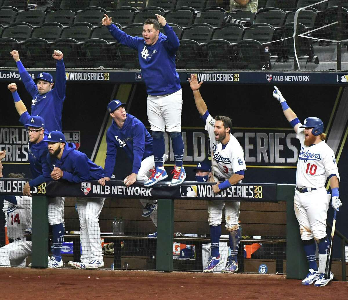 The Dodgers' dugout celebrates Mookie Betts' solo home run in the sixth inning in Game 1 at Globe Life Field in Arlington. The Dodgers, in their third World Series in four years, are seeking their first title since 1988.