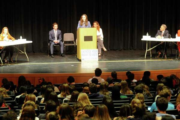 Student moderator Wyatt Radzin presents a question during a debate between candidates for the office of Greenwich First Selectman and Selectman at Greenwich High School last year. A debate will be held on Oct. 30 for the legislature races but it will be done over Zoom this time due to the pandemic.