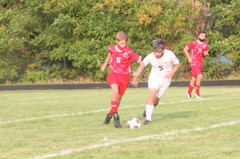 Reed City's Justin Stellini (6) goes after the ball during action this season. (Pioneer photo/John Raffel)