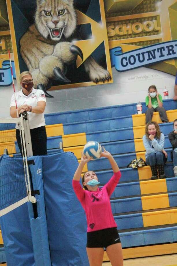 Evart's Deanna Conklin sets the ball against Pine River. (Herald Review photo/John Raffel)