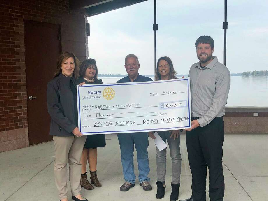 The Rotary Club of Cadillac presented the Wexford Osceola Habitat for Humanity with a donation of $10,000 in honor of their 100th year. (Submitted photo)