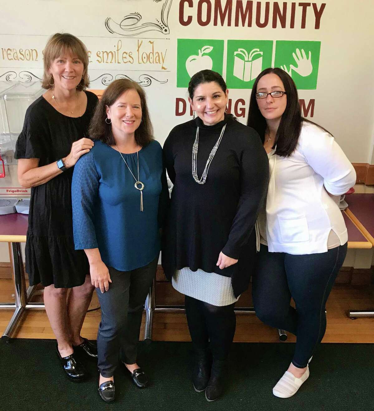 CDR kitchen coordinator Mary Johnston, volunteer coordinator Marie Mordarski, executive director Judy Barron, and administrative assistant Diana Vaicunas on a recent morning at the Community Dining Room.
