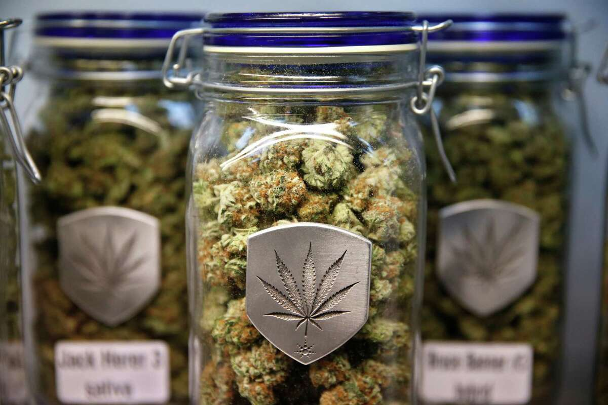 In this file photo, different strains of marijuana are displayed for sale at a marijuana dispensary