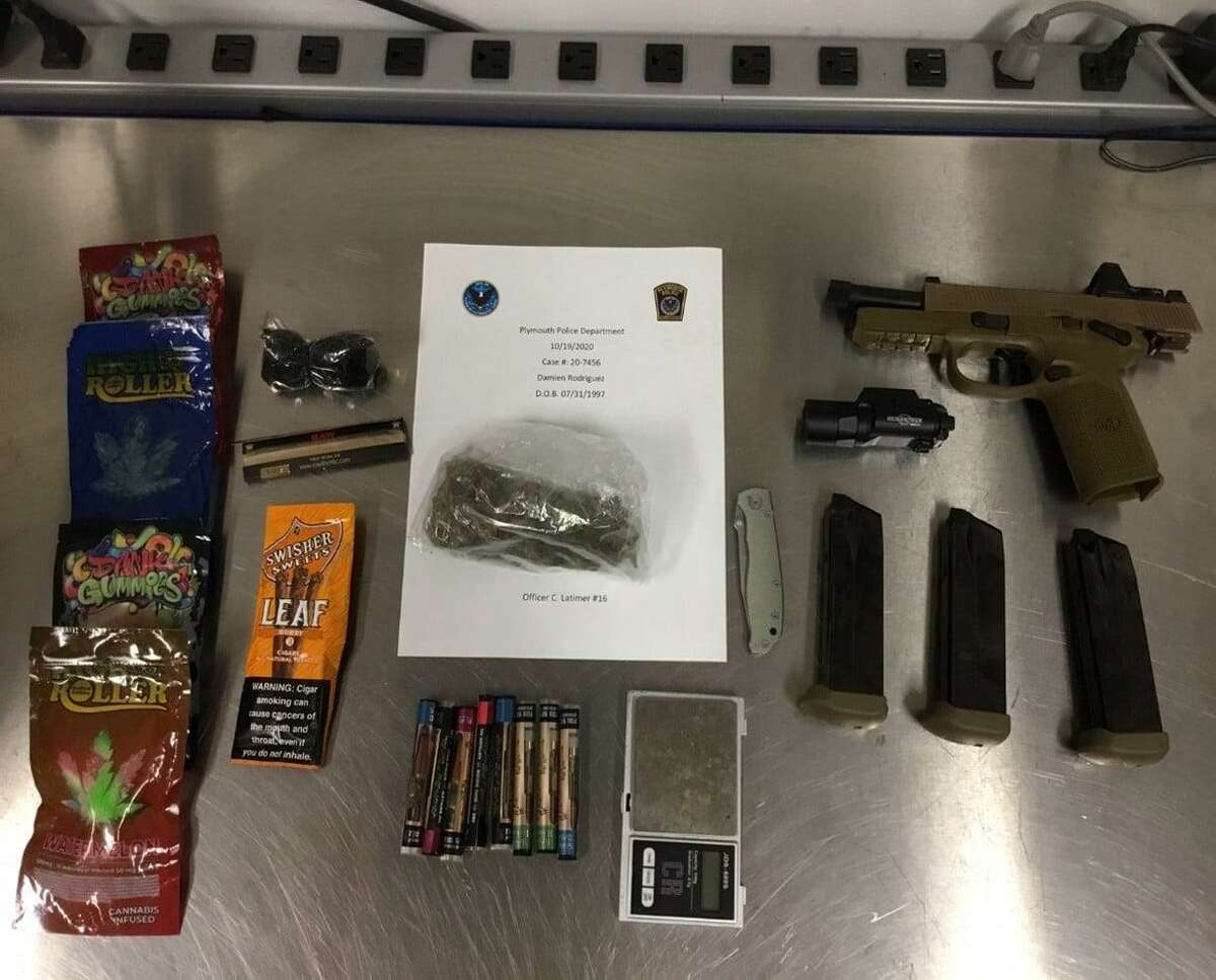 """A motor-vehicle stop by Plymouth police for an """"equipment violation,"""" led to the arrest of Damien Rodriguez, 22, of Bristol on drug and weapons charges on Monday Oct. 19, 2020. In total, 322 grams of fresh marijuana, edibles and vape cartridges were seized. A .45-caliber handgun and three high-capacity magazines were also seized."""